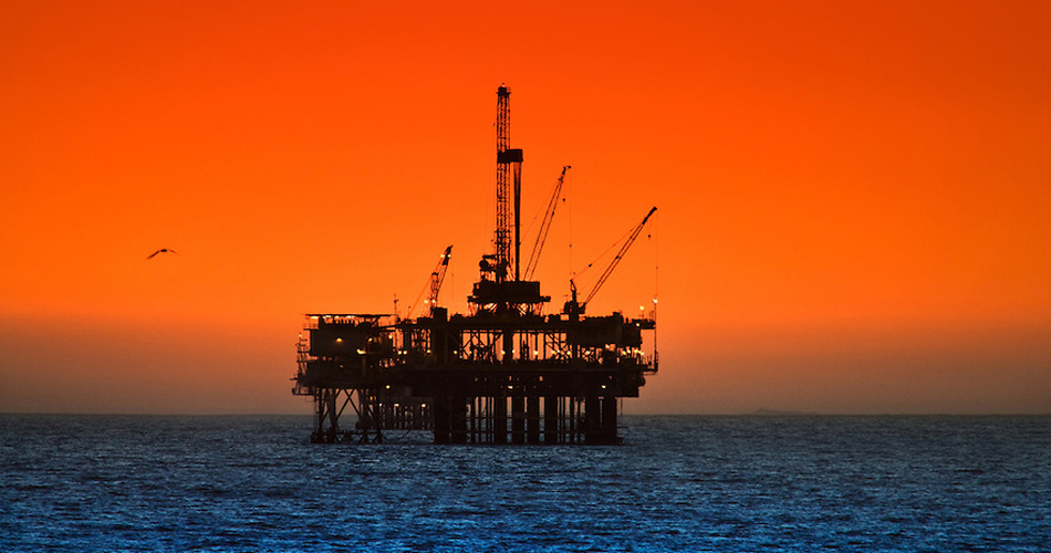 Large oil rig drilling platform off the southern california coast near Long Beach and Huntington Beach at sunset